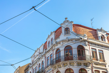Classic Porto building with the sky full of trolley wires