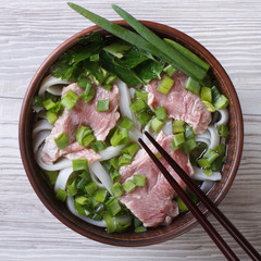 soup pho bo with beef, rice noodles and vegetables top view