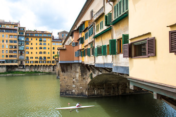 Glimpse of Arno river at  Ponte Vecchio in Florence on a cloudy