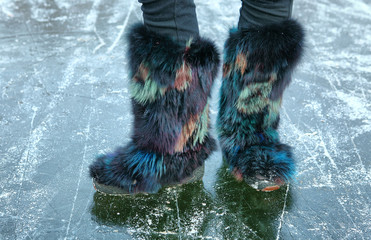 winter furry shoes on the ice surface