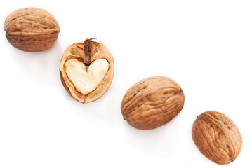 Heart in walnut on white background