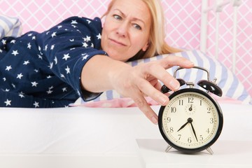 Woman put out the alarm clock