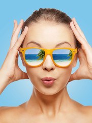amazed teenage girl in sunglasses