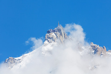 Mont Blanc peak in mist with blue sky