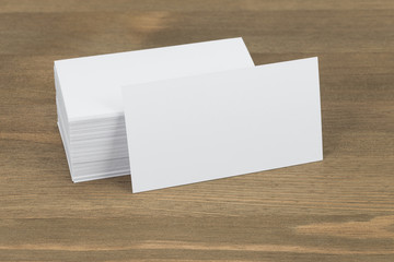 Business cards on wooden background