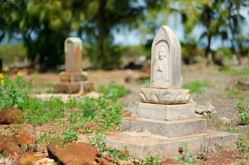 Old chinese grave headstones abandoned on Kauai