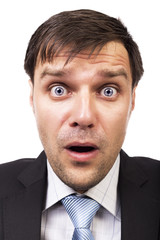 Closeup of handsome businessman with astonished expression