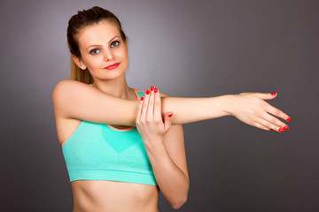 Young fitness woman doing exercises