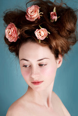 Artistic portrait of young caucasian girl with big hairstyle