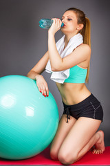 Beautiful sports woman resting after exercising with pilates bal