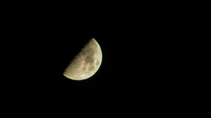 Moon going down on dark sky