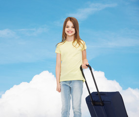 smiling little girl with suitcase