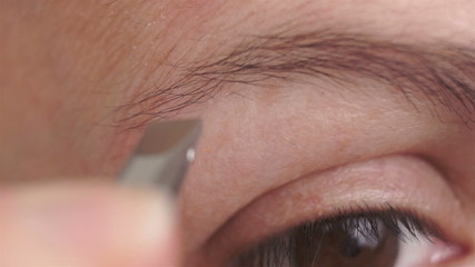 Woman Plucking Eyebrows Macro