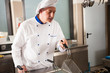 Male chef using a deep fryer