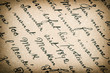 vintage paper background with vignette. old handwritten text