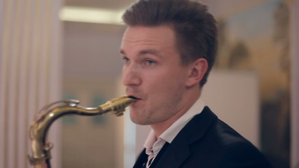 Saxophone player performs on stage.