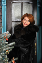 woman in a fur coat in Christmas