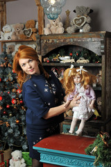 Girl with a doll in Christmas
