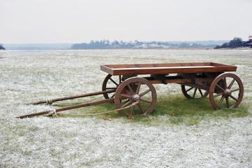 wooden cart in snowy field
