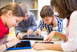 group of school kids with tablet pc in classroom - 74051621