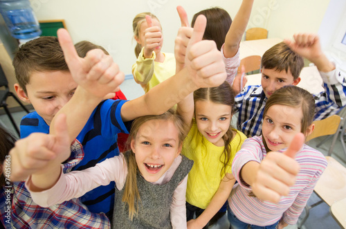 group of school kids showing thumbs up - 74051663