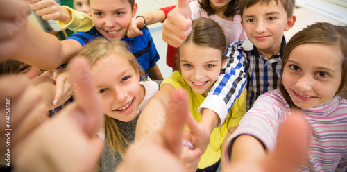 group of school kids showing thumbs up - 74051686