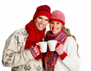 Christmas couple drinking hot tea.