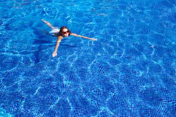 Beautiful woman in pool