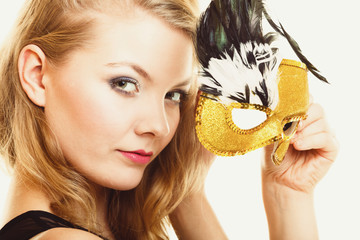 Masquerade. Beautiful girl in carnival mask