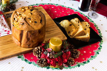 "italian typical christmas cake called ""panettone"" on table wirh"