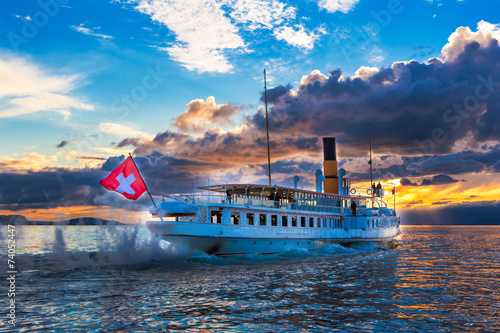 Papiers peints Lac / Etang Ancien steam boat with swiss flag floating on the lake Geneva