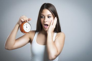 Beautiful women with clock