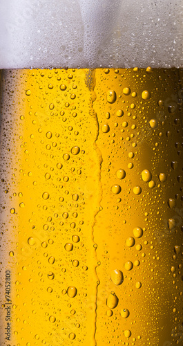 cold beer is overflowing - 74052800