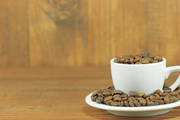 A coffee mug of coffee beans