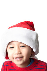 Cute Vietnamese boy wearing Christmas hat on white background