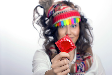 Girl with a red condom pack in the hand