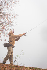 Fisherman in his hand holding spinning