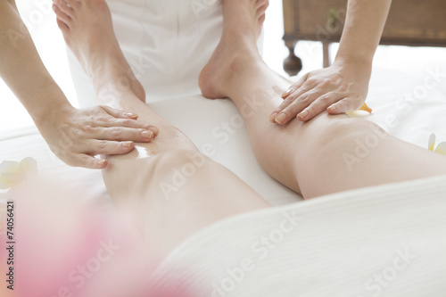 poster of Esthetician to paint the aroma oil on foot