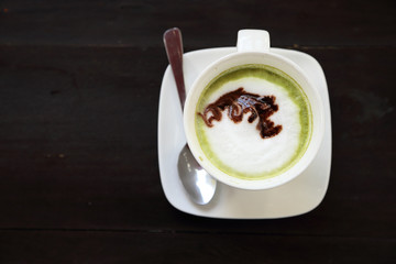 Cup of hot matcha green tea latte