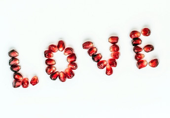 """word """"love"""" from pomegranate seeds"""