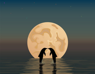 Two dolphins in the sea on the background of the moon