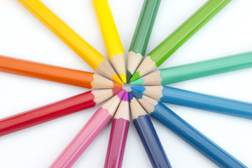 white background with colorfull pencils