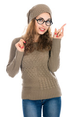 Girl in sweater showing thumb to the side
