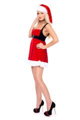Beautiful christmas Santa girl in studio. Isolated on a white ba
