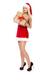 Beautiful christmas Santa girl is holding gift in studio.