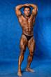 Bodybuilder flexing his muscles.