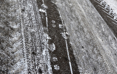 Abstract background. Snow traces on the road.