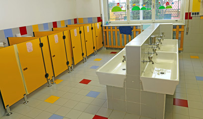 large bathroom of a nursery with white sinks