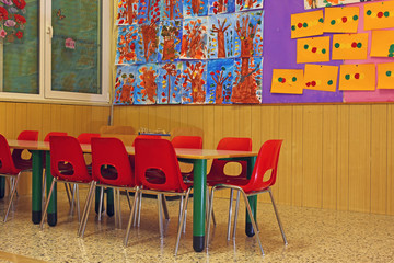 small red chairs and benches of a school for young children
