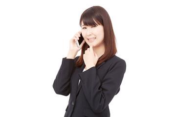 スマートフォンで通話して困るビジネスウーマン